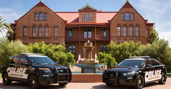Image of the new police fleet vehicles parked in front of Old Main in Tempe campus.