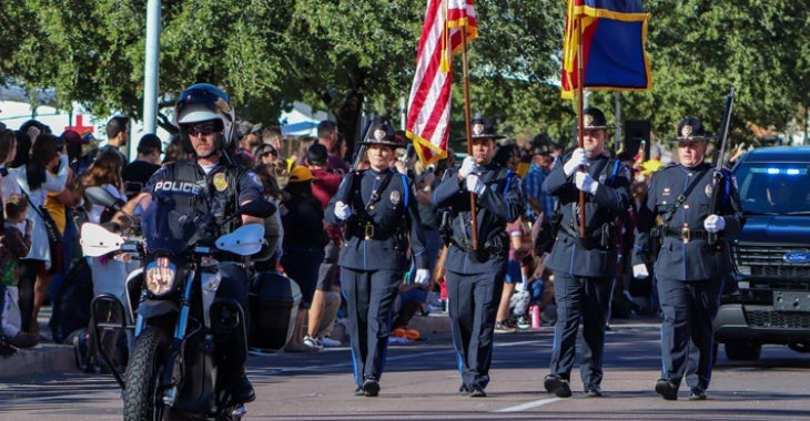 Image of police officers marching during the homecoming parade